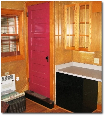 There is no pink door in the plans for the remodeled kitchen