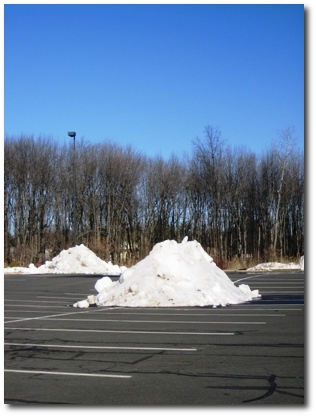 Lonely snow piles in the parking lot
