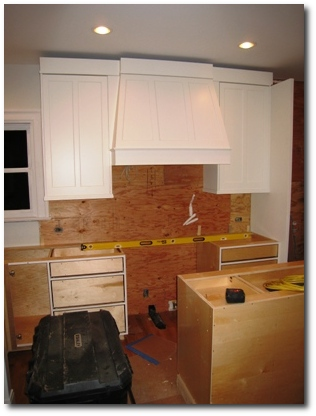 Cabinets magically appear in the kitchen