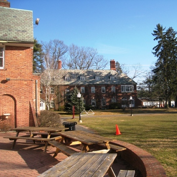 Looking from the back patio of Johnson House towards Butterworth Hall